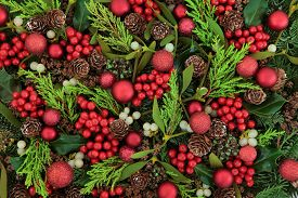 stock photo of greenery  - Christmas abstract background with red bauble decorations - JPG