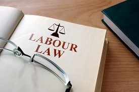 image of labourer  - Notepad with words labour law and glasses - JPG