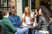 Multiracial Group Of Five Friends Having A Coffee Together poster
