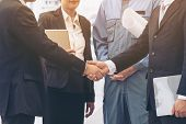 Businessmen Handshake With Business Team Background poster
