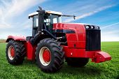 foto of sugar industry  - The Tractor on a green field - JPG