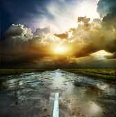 foto of field_stone  - Asphalt road and the puddles at sunset - JPG