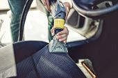 Close Up Details Of Car Steats Vacuuming Using Steaming Tools poster