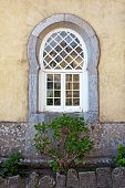 pic of saracen  - Ancient window with an arabic style arch from Pena palace in Sintra Portugal - JPG