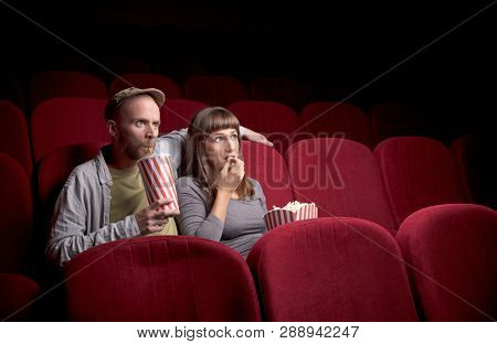Young cute couple sitting alone