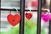 Heart Shaped Love Padlock At The Fence Symbolizing A Strong Marriage poster