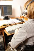 stock photo of people work  - Handicapped woman on wheelchair working from home as telemarketer - JPG
