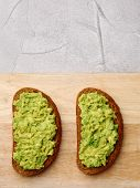 Sandwich With Guacamole On Light Background. Breakfast Concept poster