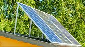 8976_a_solar_panel_on_the_yard_outside.jpg poster