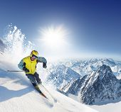 stock photo of snow-slide  - Skier in high mountains - JPG
