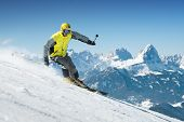 pic of snow-slide  - Skier in high mountains - JPG