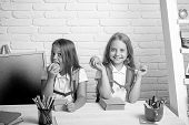 Little Girls Eat Apple At Lunch Break. Back To School And Home Schooling. Friendship Of Small Sister poster