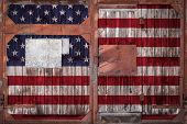 Close-up Of Old Warehouse Gate With National Usa Flag. The Concept Of Export-import Usa, Storage Of  poster