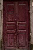 Aged Wooden Door Painted Maroon. Vintage House Facade With A Door. Wood Vinous Texture Of A Door. Ol poster