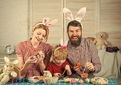 Happy Easter Family Paint Eggs. Easter, Mother, Father And Child In Bunny Ears. Happy Family Celebra poster