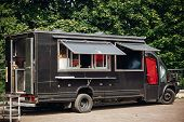 Food Van Truck. Stylish Black Mobile Food Truck With Burgers And Asian Food At Street Food Festival. poster