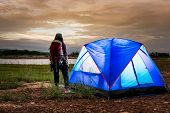 Young Women Standing Near The Tent And Looking To Mountain View With Lake. Activity Camping By Natur poster