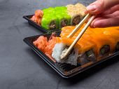 Tasty Sushi Bar, Eating Sushi With Chopsticks. California Sushi Roll Set With Salmon, Vegetables, Fi poster