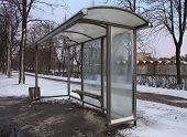 pic of bus-shelter  - An Empty Bus Stop in winter city - JPG
