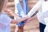 A Group Of Girls Kids Walking In The Summer Forest Put Their Hands Together. The Concept Of Friendsh poster