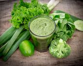 picture of juices  - Healthy green vegetable juice on wooden table - JPG