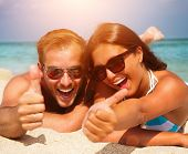 stock photo of laugh  - Happy Couple in Sunglasses having fun on the Beach - JPG