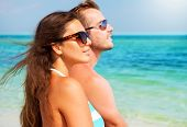 stock photo of hot couple  - Happy Couple in Sunglasses having fun on the Beach - JPG