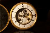 stock photo of tick tock  - showing the face and dial of an old antique british victorian clock - JPG