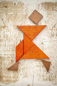 picture of tangram  - abstract figure of a female dancer built from seven tangram wooden pieces - JPG