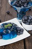 stock photo of jello  - Fresh made Blueberry Jello on wooden background - JPG