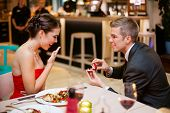 stock photo of proposal  - Young man romantically proposing to girlfriend and offering engagement ring - JPG