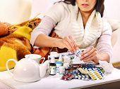 stock photo of home remedy  - Woman with remedy having  flue in bed - JPG