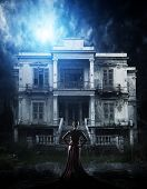 picture of abandoned house  - Blonde Woman in red dress at haunted house - JPG