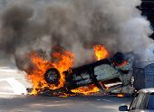 image of anti-terrorism  - burning car after street riots and clashes - JPG