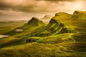 stock photo of landslide  - Scenic view of Quiraing mountains sunset with dramatic sky in Scottish highlands Isle of Skye United Kingdom - JPG
