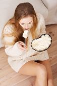 Young depressed woman is eating big bowl of ice creams to comfort herself. Depression, bulimia and d