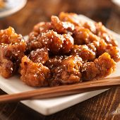 stock photo of chopsticks  - chinese sesame chicken with chopsticks - JPG