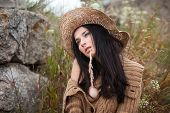 foto of nu  - Portrait of seminudea girl against background of nature and old stones - JPG