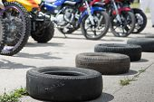 image of heatwave  - a number of old tires lies on the road under the bright summer sun - JPG