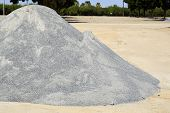 stock photo of sand gravel  - Sand gravel for road construction is on the ground - JPG