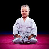 stock photo of aikido  - Little girl aikido fighter on black - JPG