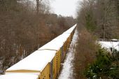 image of freightliner  - A train moving down the tracks during a snow srorm - JPG