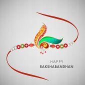foto of rakhi  - Beautiful rakhi decorated with peacock feathers and colorful pearls on grey background for Raksha Bandhan celebrations - JPG