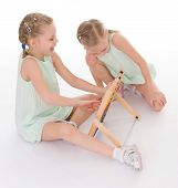image of montessori school  - Cute sisters work in the Montessori environment - JPG