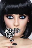 stock photo of lollipops  - Conceptual portrait of young beautiful blue - JPG
