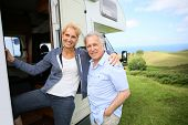 pic of camper  - Senior couple climbing camper door steps - JPG