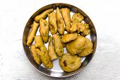 image of brinjal  - Indian evening snack or savoury made from chilly and brinjal dipped on gram flour and fried in cooking oil - JPG