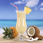 stock photo of pina-colada  - Pina Colada cocktail drink with fruits on the beach - JPG