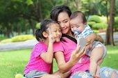 picture of kiddie  - Asian family selfie in the park - JPG