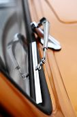 stock photo of wiper  - Color vertical shot of a vintage car screen wiper - JPG